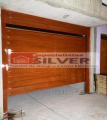 Fabricación  e instalación de puertas levadizas seccionales cercos eléctricos especialistas silver